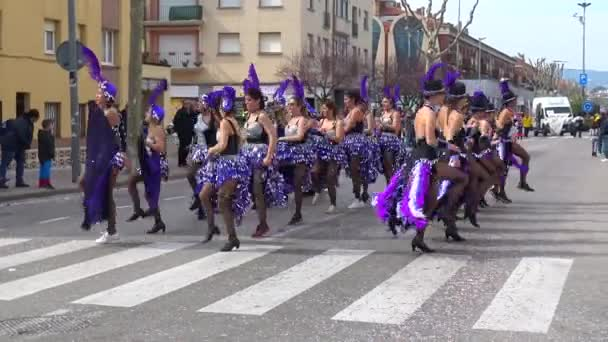 Traditional carnival in a Spanish town Palamos in Catalonia. Many girls in costume and interesting make-up dancing on the street.  03. 02. 2019 Spain