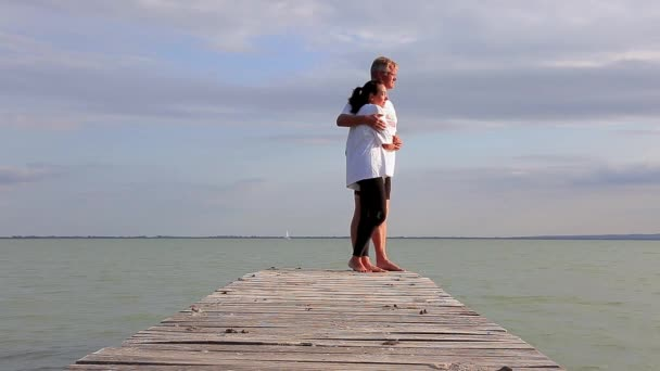 Middle age couple on the pier in a lake Balaton of Hungary at summertime