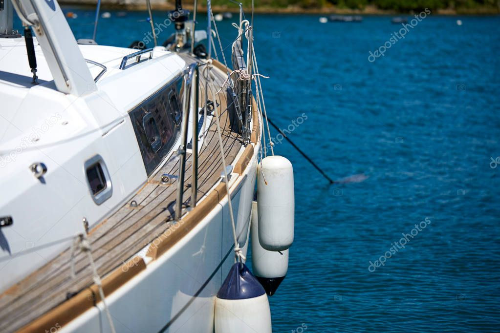 yacht floating in sea at sunny day