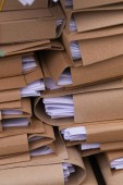 stacks of paper files in office, close-up