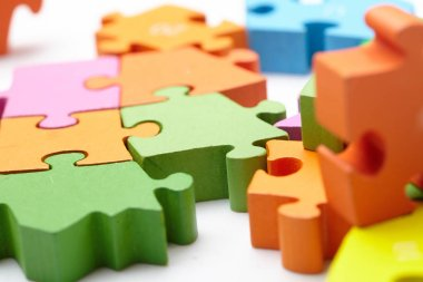 bright colorful puzzle pieces, close-up