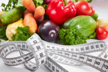 fresh healthy vegetables with measure tape
