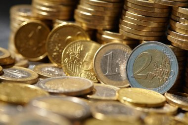 pile of golden euro coins, close-up