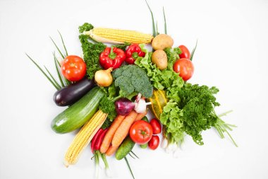 pile of fresh vegetables isolated on white background, close-up