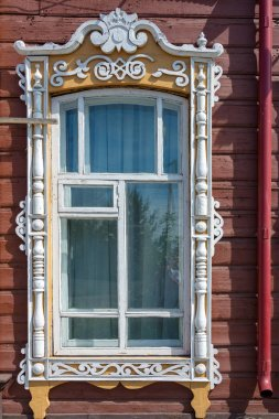 Fragment of the facade of an old wooden building, the former home of commoner Blinchevsky. Mariinsk, Kemerovo region
