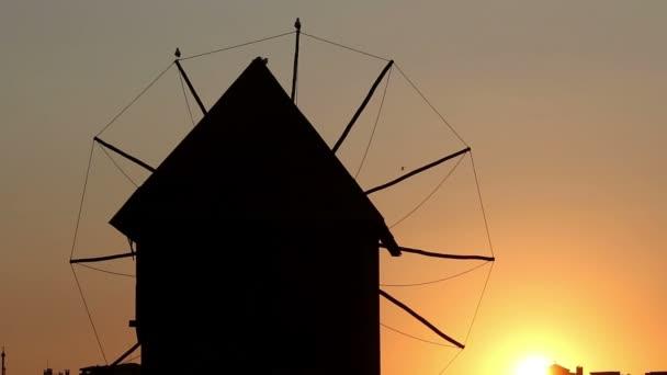 Old windmill silhouette sunset Nessebar Bulgaria