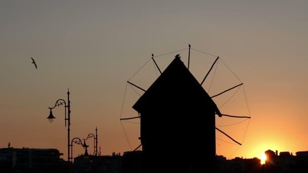 Old windmill sunset Nessebar Bulgaria