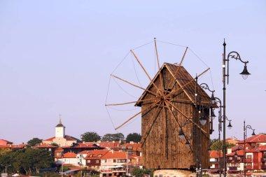"Картина, постер, плакат, фотообои ""деревянная ветряная мельница и старый город Несебр в Болгарии"", артикул 262825612"