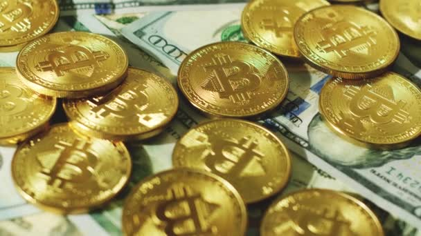 Close Shot Composed Gold Physical Bitcoins Top Various Dollar Banknotes Stock Video