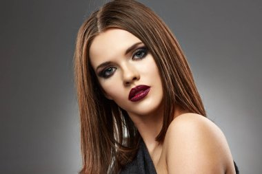 portrait of beautiful young woman with smoky eyes make up