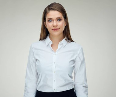 Business woman with light smile wearing white shirt. Isolated studio portrait.