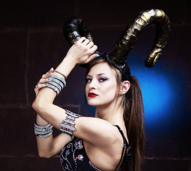 beautiful dancer wearing leather and horns