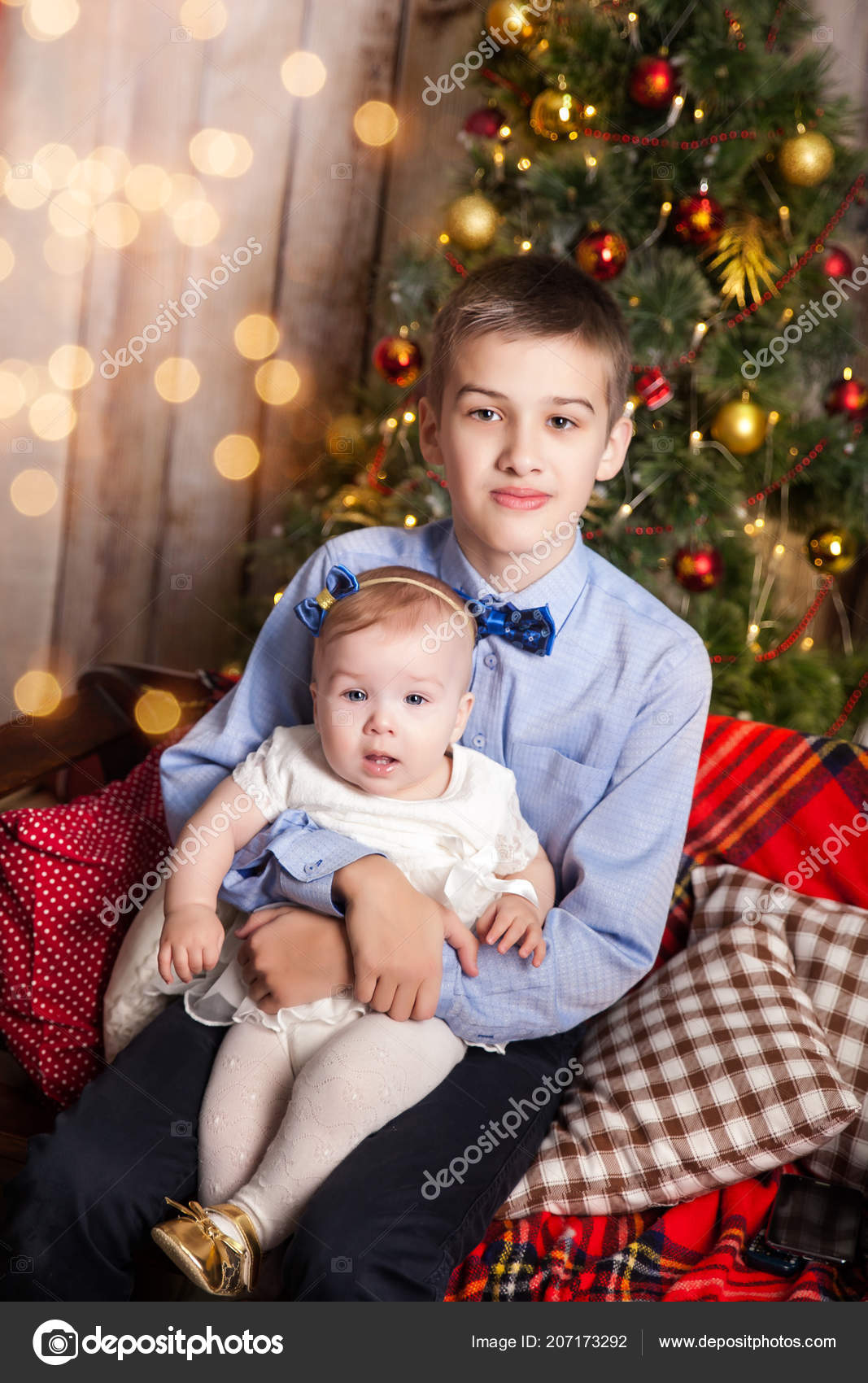 Pictures Big Brother Big Brother With Little Sister In A Christmas Studio Stock Photo C Gorchichko 207173292