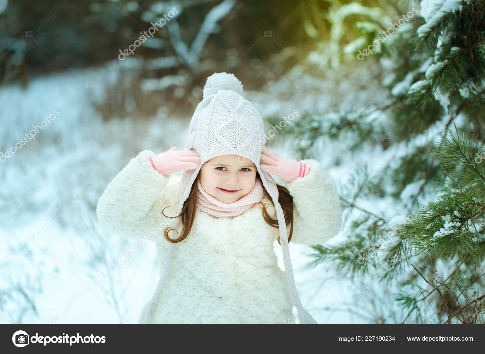ea7f98563041 Little girl in a white fur coat in the winter forest — Stock Photo ...