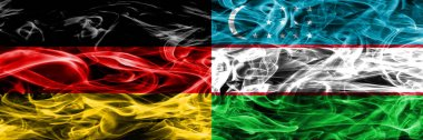 Germany vs Uzbekistan smoke flags placed side by side. German and Uzbekistan flag together
