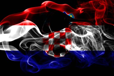 National flag of Croatia made from colored smoke isolated on black background. Abstract silky wave background.