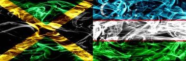 Jamaica vs Uzbekistan, Uzbek smoke flags placed side by side. Thick colored silky smoke flags of Jamaican and Uzbekistan, Uzbek