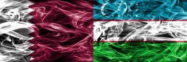 Qatar vs Uzbekistan, Uzbek smoke flags placed side by side. United Arab Emirates. UAE
