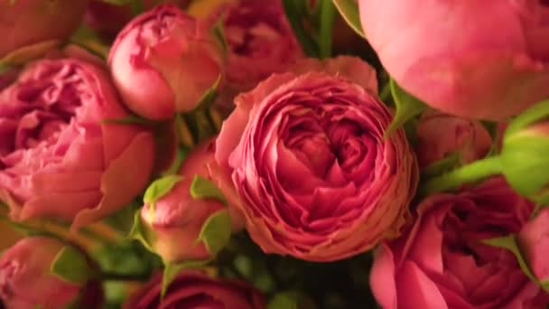 Bouquete from pink and red flowers roses