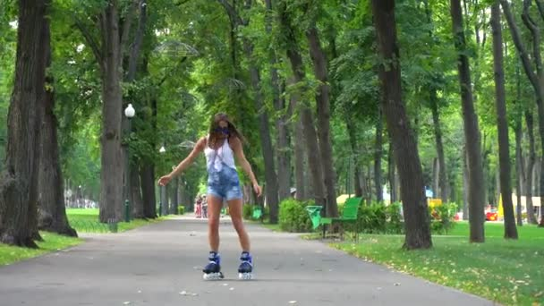 Woman is riding roller skates in park