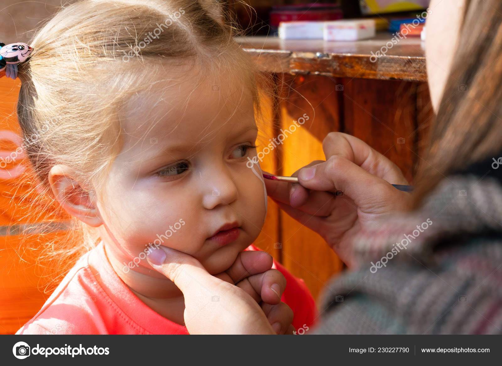 dc3b16d06ba8 Woman painting cute ornament on face of sweet little girl on sunny day in  park — Photo by ...
