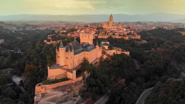 Aerial view of Alcazar of Segovia, a medieval fortress in the central part of Spain. After sunset view. 4K, UHD