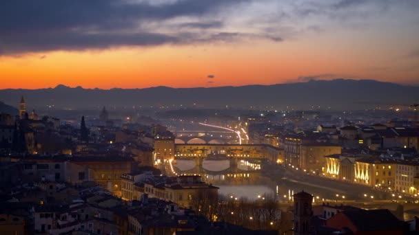 Florence after sunset, Italy. Night view of illuminated Florence old city center with sunset sky at background. Panning shot, 4K