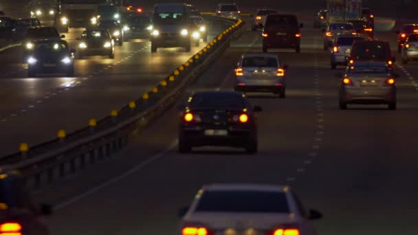 Car traffic on a road. Many cars driving in opposite directions in the evening. UHD