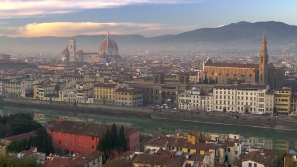 City of Florence, Italy before sunset. Panorama of Santa Maria del Fiore Cathedral, Arno River and Ponte de Vecchio Bridge. Panning shot, 4K