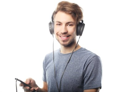 Man holding mobile phone and lictening to music over white background