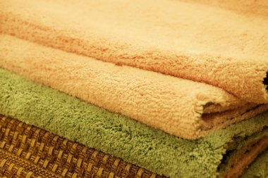 Assortment of different carpets in store. closeup