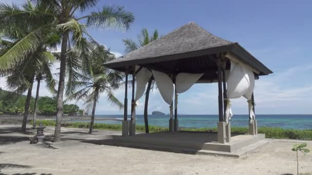 Cinemagraph.Arbor among palm trees on the bank of the tropical beach in the sea resort
