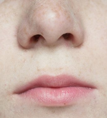 Close up shot of woman nose and lips