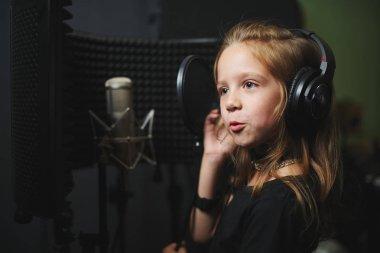 little girl singing in recording studio