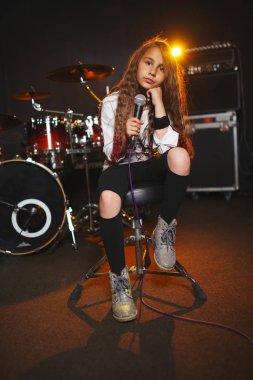 beautiful girl singing in recording studio
