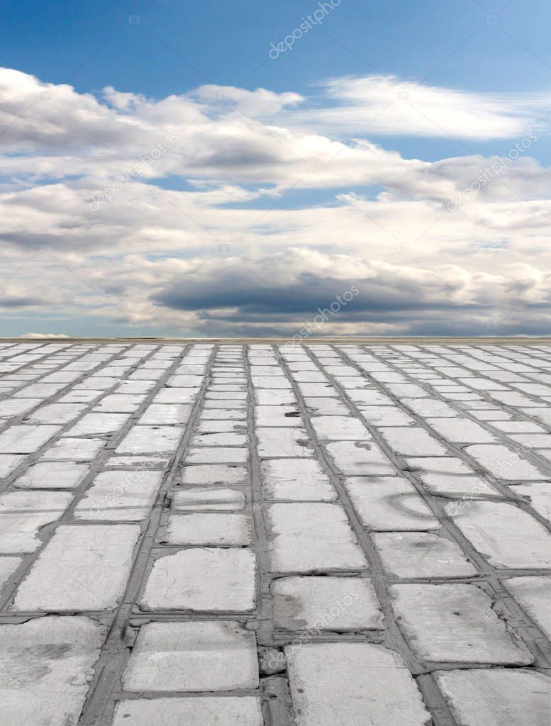 old brick road on the blue sky background