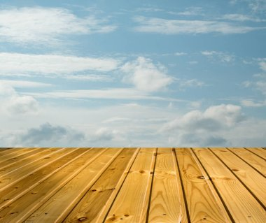 blue sky clouds with wooden walkway