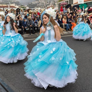Funchal; Madeira; Portugal - April 22; 2018: A group of women in blue dresses are dancing at Madeira Flower Festival Parade in Funchal on the Island of Madeira. Portugal.