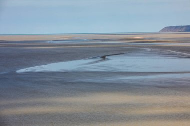 Low tide in the bay in front of Mont Saint Michel in Normandy, France.
