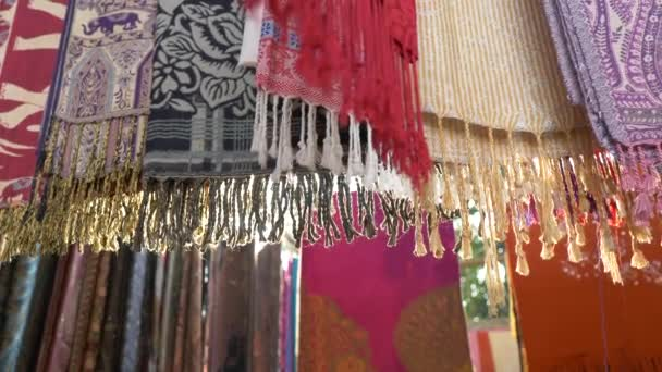 Multi colored fabric hanging down and moving slowly in slow motion