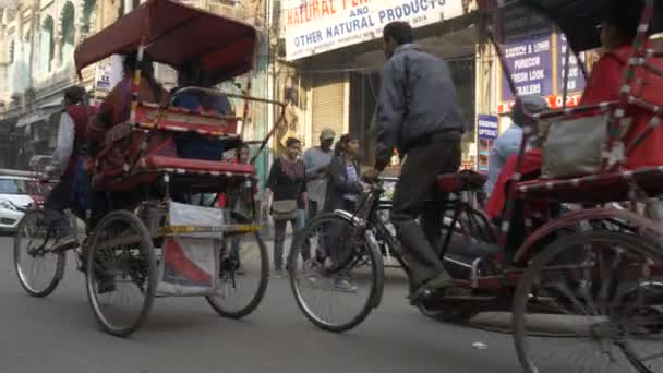 STREETS OF NEW DELHI INDIA - NOV 2018 : BUSY STREET OF INDIA WITH PEOPLE WALKING CAPTURED IN SLOW MOTION