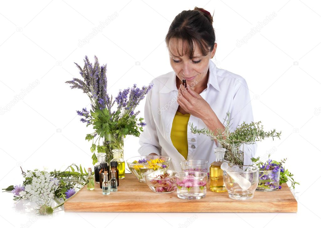 woman and essential oils in front of white background