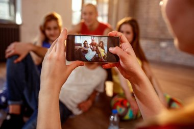 Break dance, freestyle, hip-hop and street dance concept- taking picture of smiling modern dancer friends
