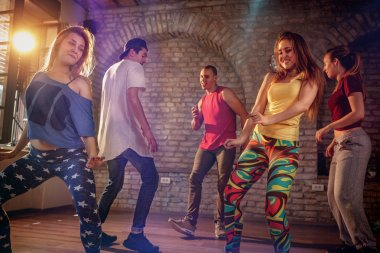 Group of young modern dancers dancing in the studio. Sport, dancing and urban concept