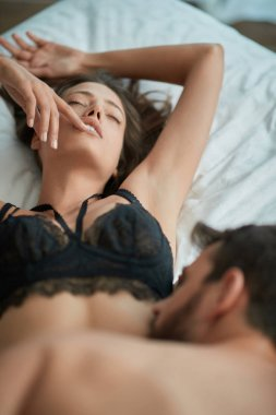 Young passionate man and woman making love in hote
