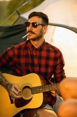 Portrait of hipster man with guitar