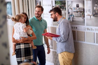 Family with salesman in store for household