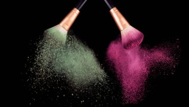 Makeup concept. Brush with powder explosion on black background stock vector