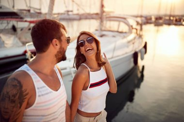Smiling couple  enjoying at vacation and  going on yacht. stock vector