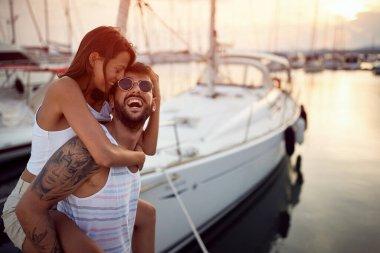 Smiling man and woman  enjoying at vacation trip at  sunset. stock vector